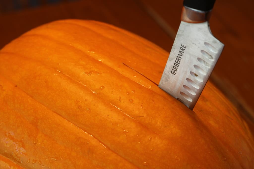 cutting pumpkin