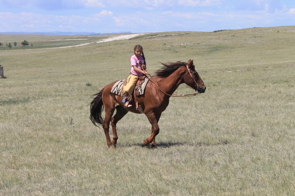 cowgirl riding a horse