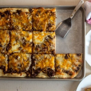 pan of bbq beef pizza , cut into slices