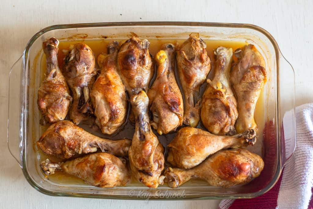 Baked Balsamic Chicken legs in a  glass baking dish