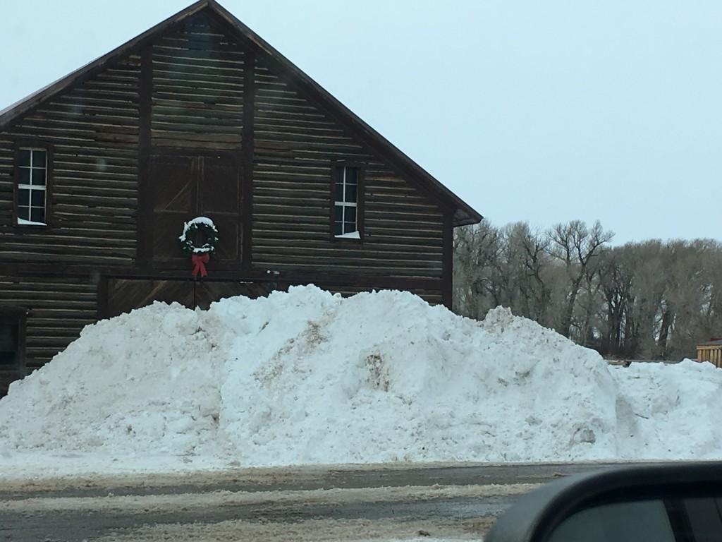 snow drift by barn