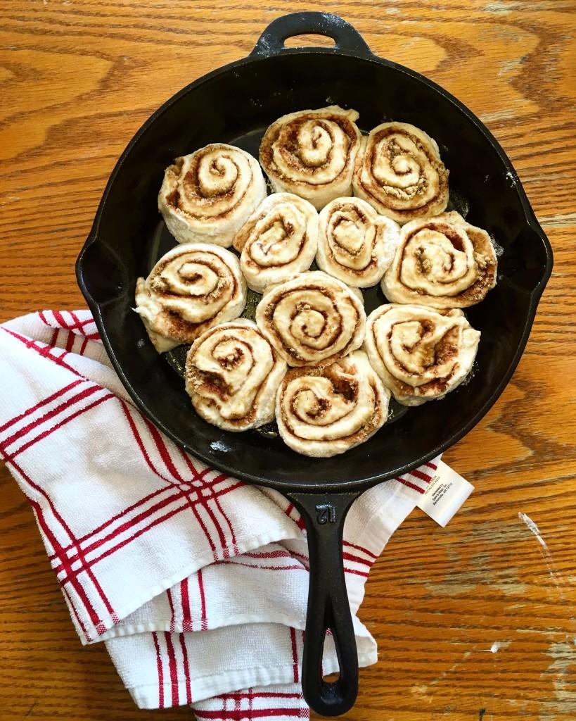sourdough cinnamon rolls in cast iron pan
