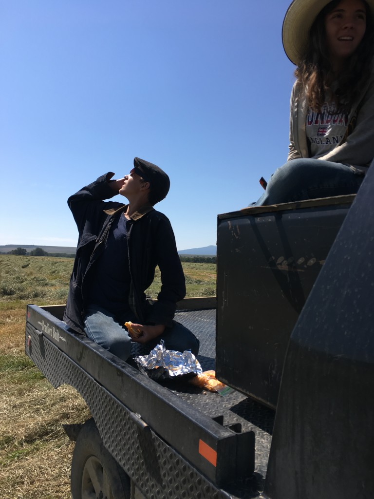 Taking a break from raking hay, to eat a bite and watch the eclipse.