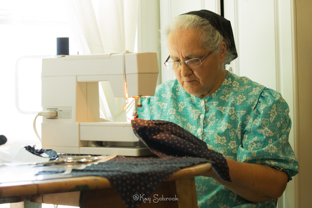 Mom sewing a dress for Reata.