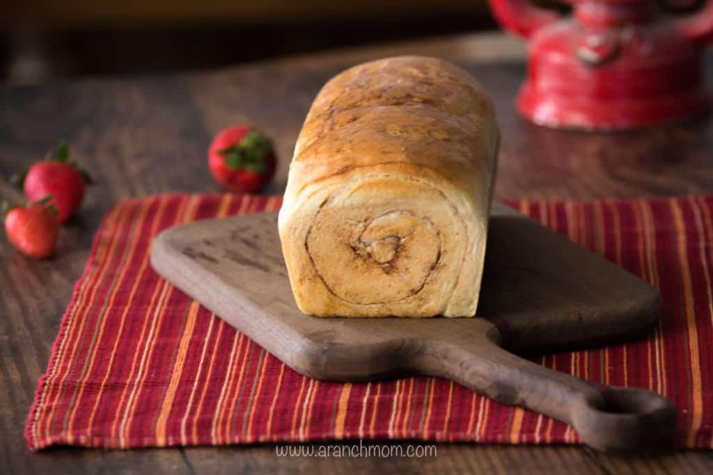 Cinnamon Bread uncut on bread board