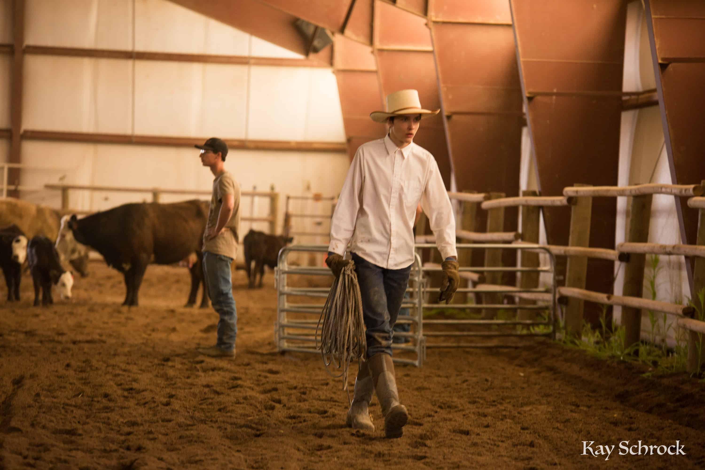 Esh Branding in Colorado - cowboy carrying rope