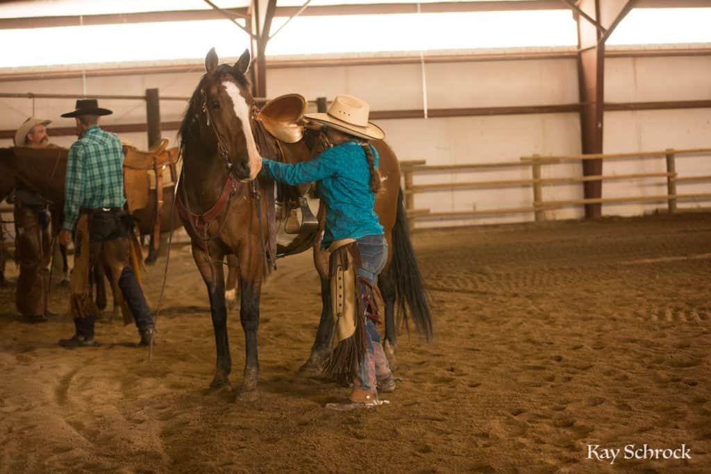 Esh Branding in Colorado - cowgirl and horse