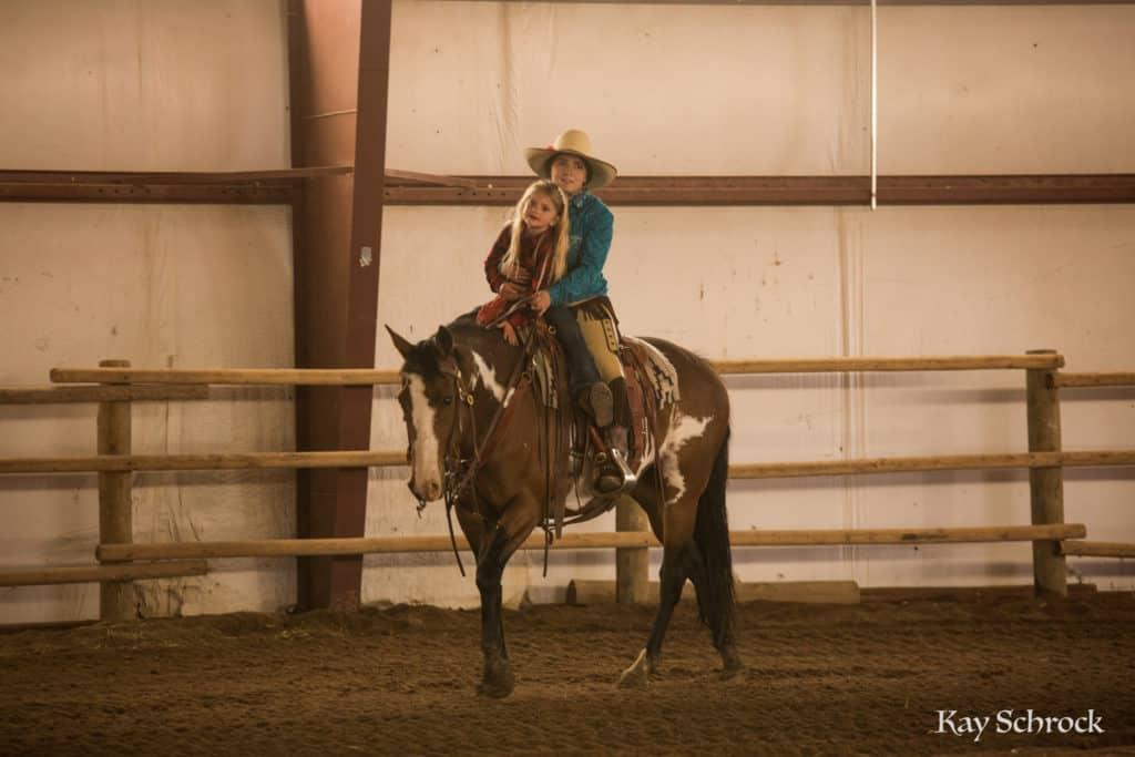 Esh Branding in Colorado - giving a kid a horseback ride