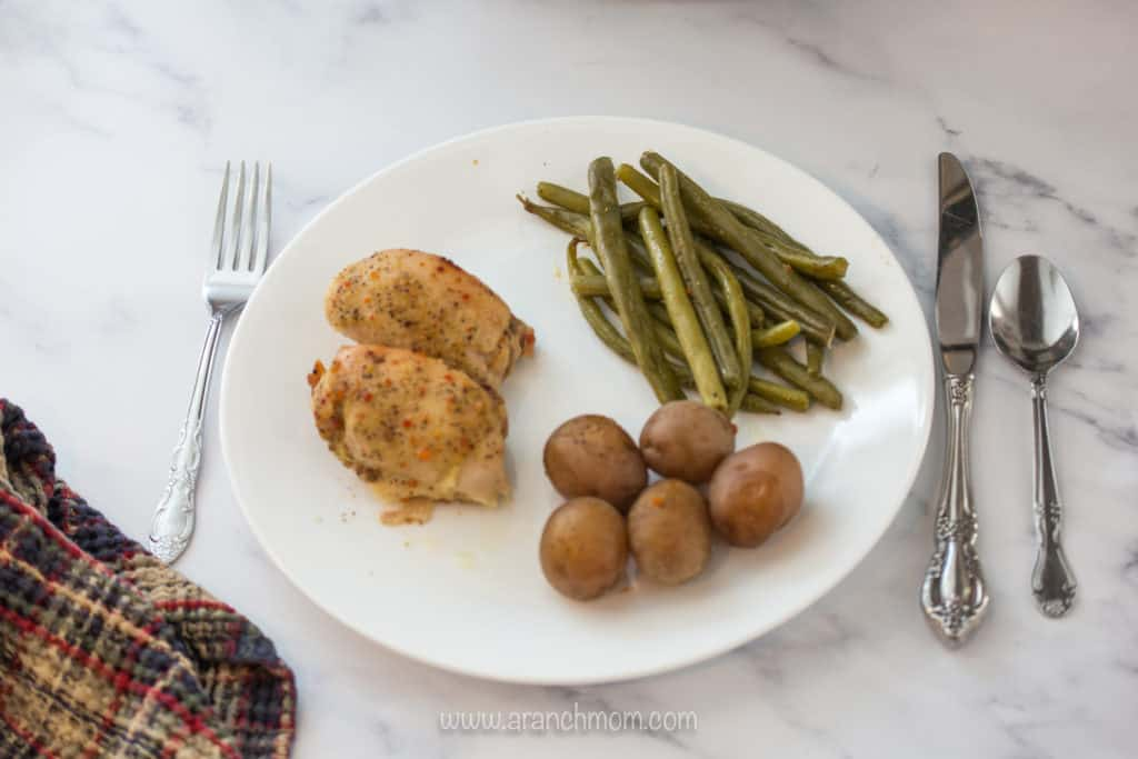 plate with chicken, potatoes, green beans