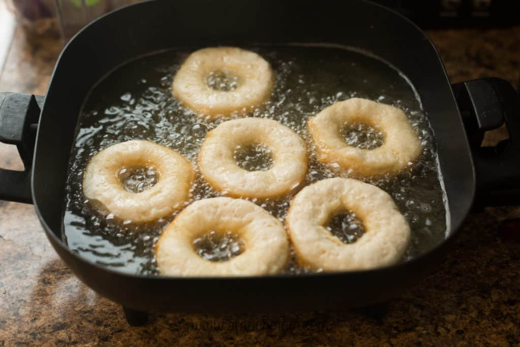 donuts frying in hot oil