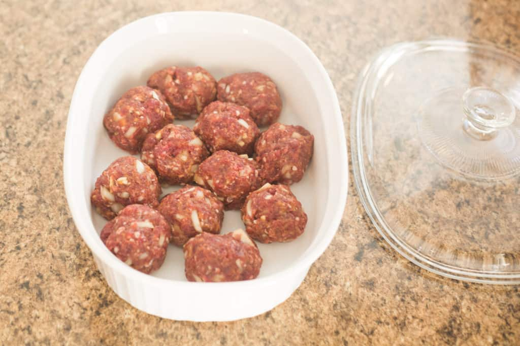 raw meatballs in caserole dish