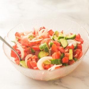 bowl of tomato & cucumber salad