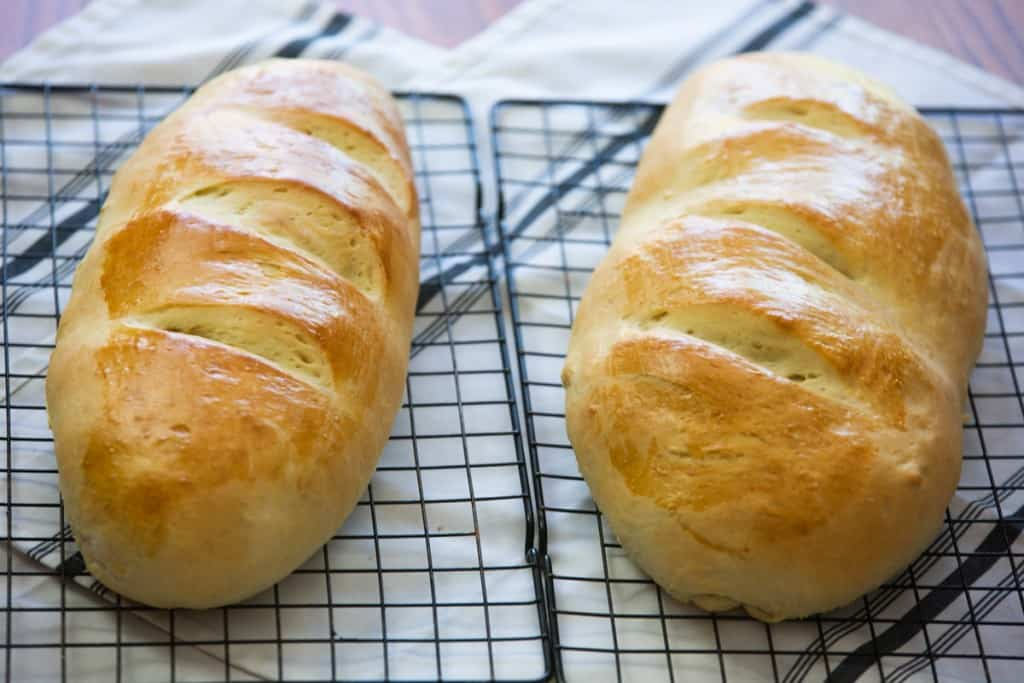 two loaves French bread on cooling rack