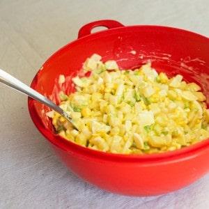 potato salad in large red bowl