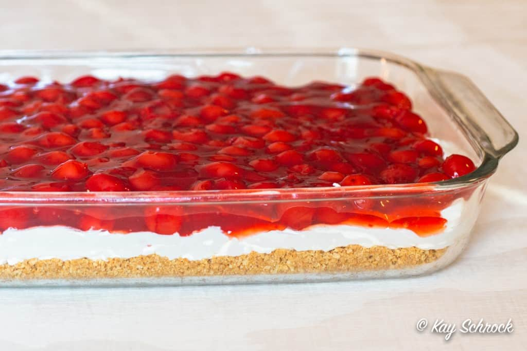 Finished pan of layered cherry cheesecake dessert