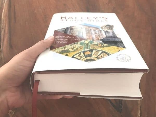 hand holding NIV Halley's Study Bible