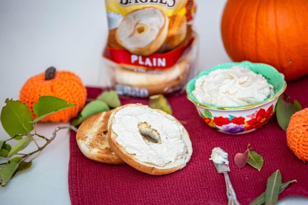 Pumpkin Spice cream cheese spread on bagel