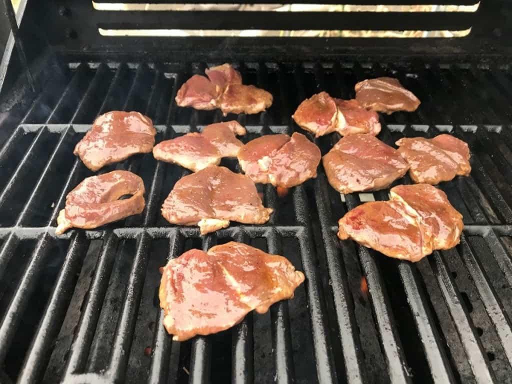 raw antelope steak on grill