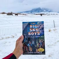The Big Sky Boys, by Todd Linder Book held up against horses in background