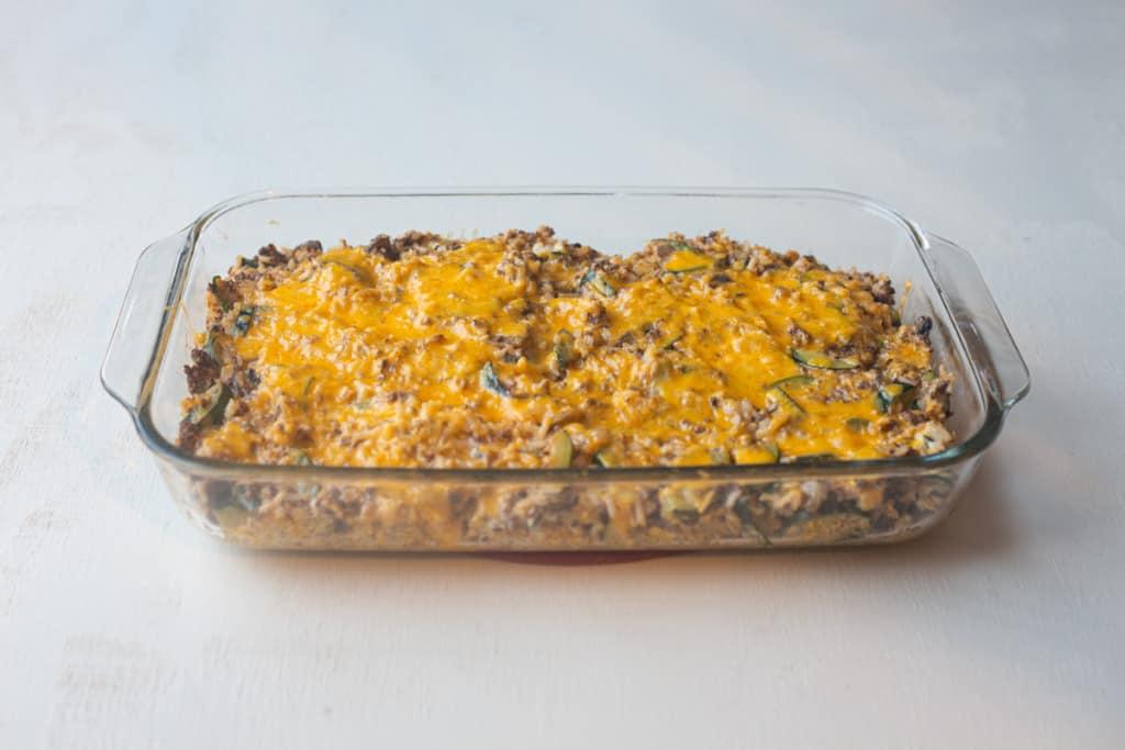zucchini ground beef casserole in glass pan