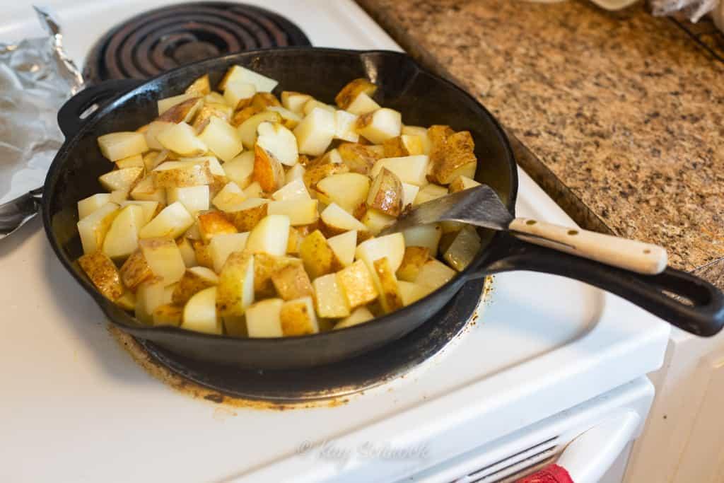 potatoes frying in pan