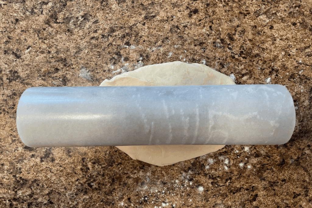 rolling pin on ball of tortilla dough