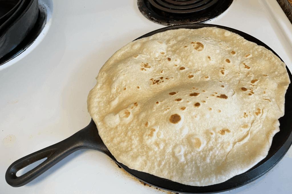 puffed up tortilla on skillet