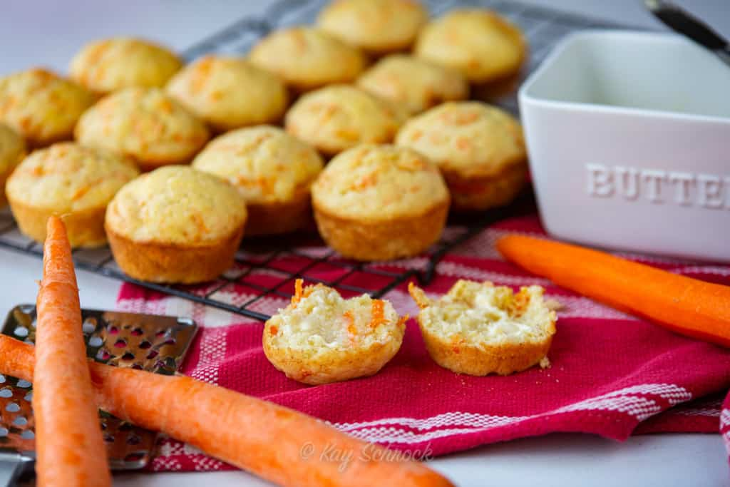 Banana Carrot Muffins on red towel with carrots