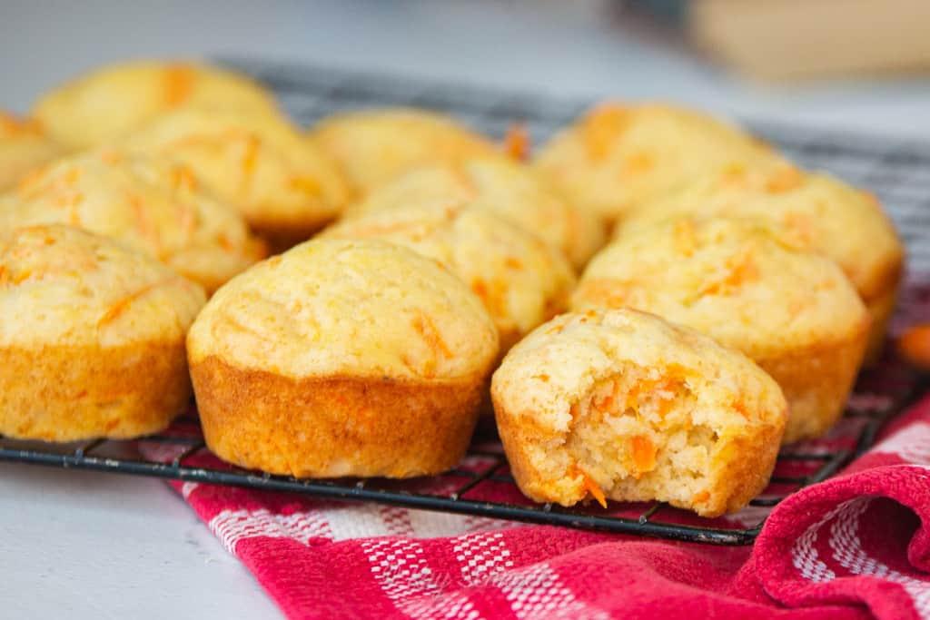baked banana carrot muffins on rack