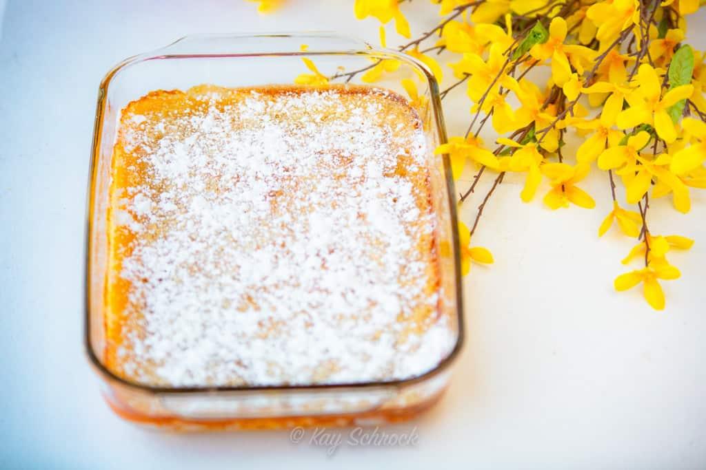 pan of lemon bars and yellow flowers