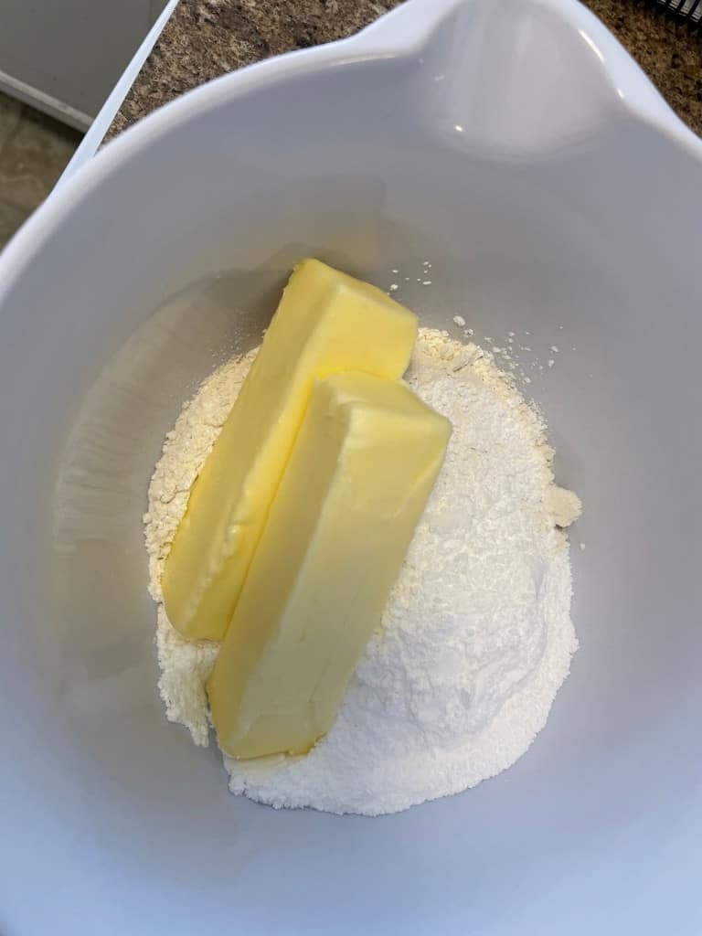 butter sticks and flour in mixing bowl