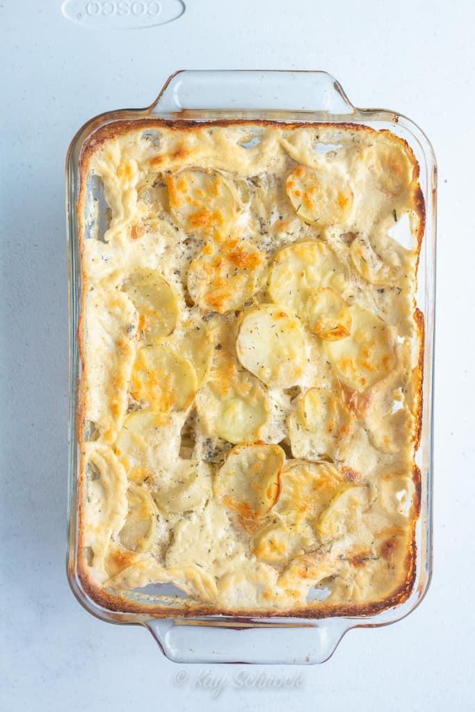 scalloped potatoes in glass baking dish