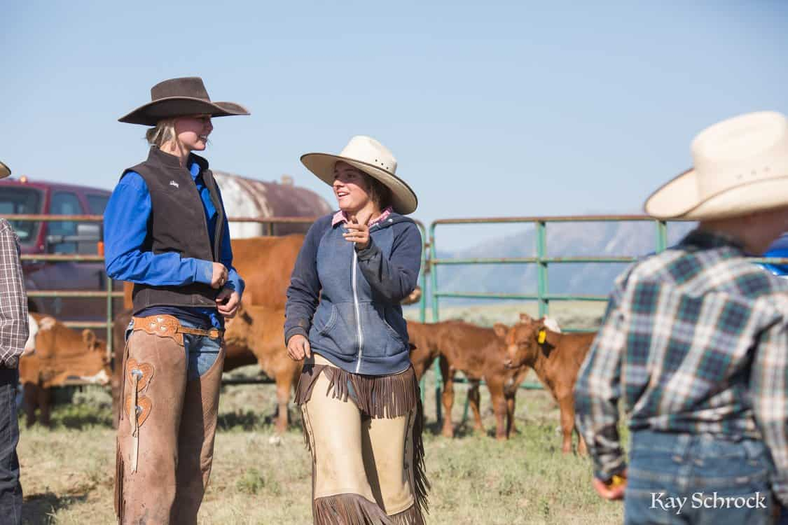 cowgirls talking together at a branding