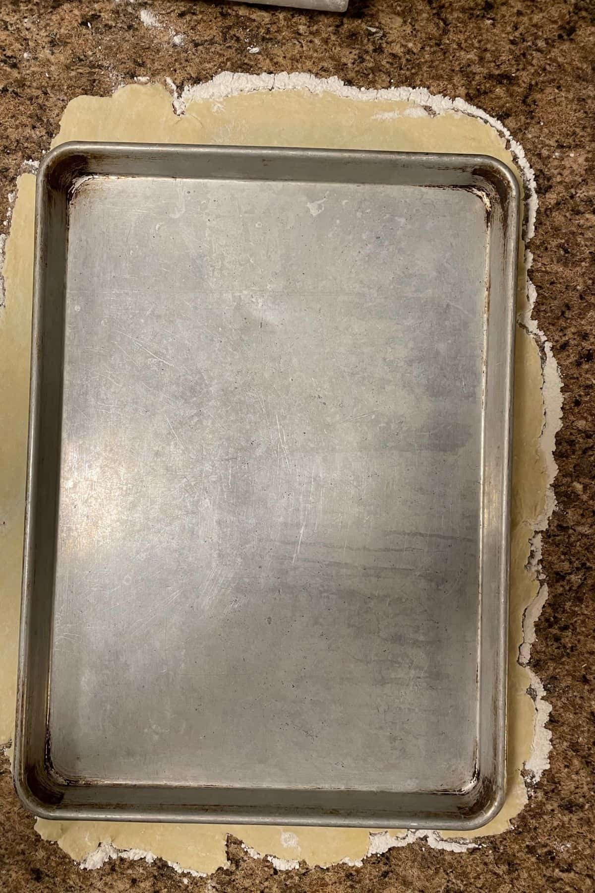 sheet pan sitting on top of pie crust