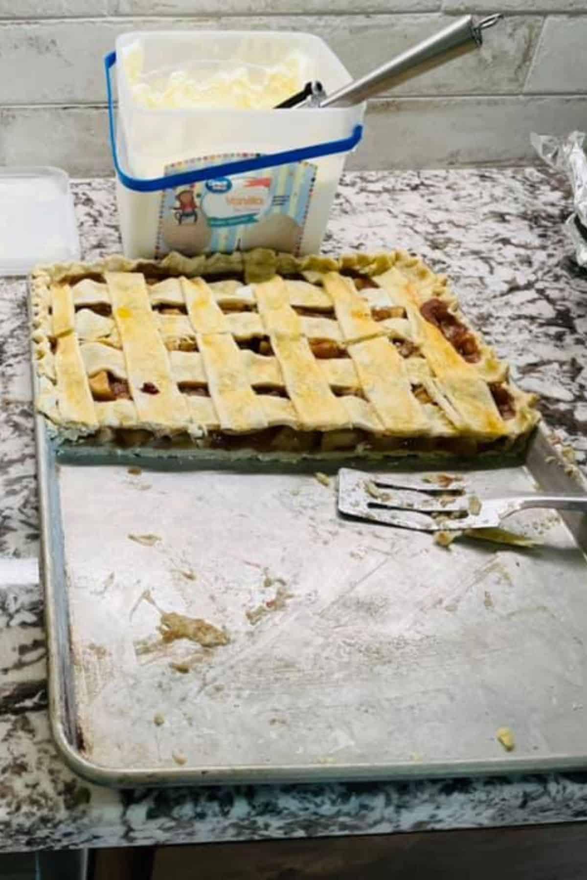 apple slab pie on counter beside ice cream