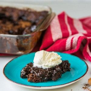 chocolate pudding cake on saucer with ice cream