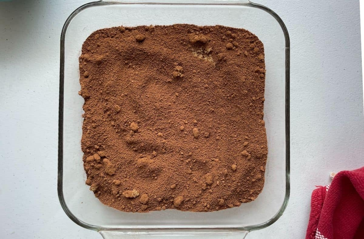 brown sugar and cocoa mixture over choc cake